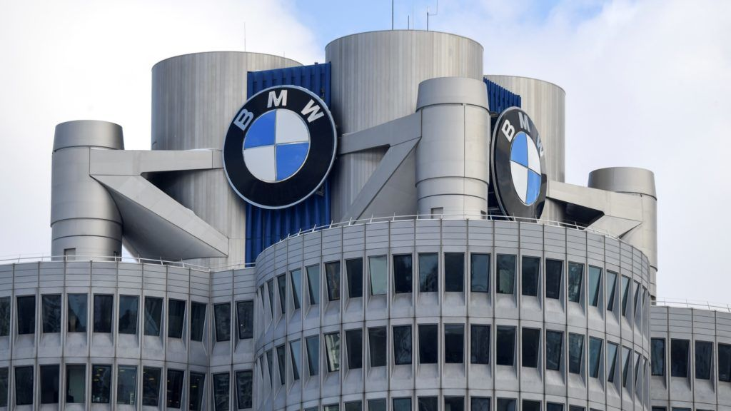 The BMW logo is seen on the top of the headquarters of German carmaker BMW in Munich on March 20, 2018.  The company's annual press conference will take part in Munich on March 21, 2018.     / AFP PHOTO / CHRISTOF STACHE