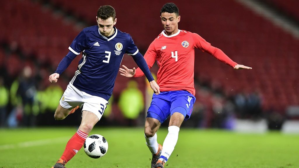 Scotland's defender Andrew Robertson (L) vies with Costa Rica's defender Ian Smith during the International friendly football match between Scotland and Costa Rica at Hampden Park in Glasgow, Scotland on March 23, 2018. / AFP PHOTO / NEIL HANNA