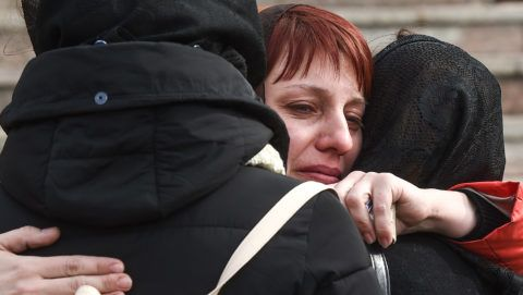 Women react during a funeral service for a victim of a shopping mall fire in the industrial city of Kemerovo in western Siberia on March 28, 2018. Russia on March 28, 2018 held a national day of mourning for the victims of a devastating blaze in a shopping centre in the Siberian city of Kemerovo that killed at least 64, many of them children. / AFP PHOTO / Dmitry Serebryakov