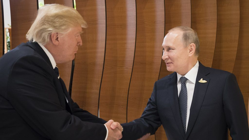 """This handout taken on July 7, 2017 released by the German government shows US President Donald Trump (L) shaking hands with his Russian counterpart Vladimir Putin during a G20 summit in Hamburg, northern Germany, on July 7, 2017. Leaders of the world's top economies gather from July 7 to 8, 2017 in Germany for likely the stormiest G20 summit in years, with disagreements ranging from wars to climate change and global trade. / AFP PHOTO / Bundesregierung / Steffen KUGLER / RESTRICTED TO EDITORIAL USE - MANDATORY CREDIT """"AFP PHOTO / BUNDESREGIERUNG"""" - NO MARKETING NO ADVERTISING CAMPAIGNS - DISTRIBUTED AS A SERVICE TO CLIENTS == NO ARCHIVE"""
