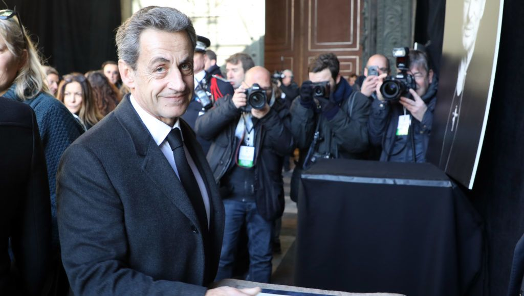Former French President Nicolas Sarkozy arrives at La Madeleine Church for the funeral ceremony in tribute to late French singer Johnny Hallyday on December 9, 2017 in Paris.  French music icon Johnny Hallyday died on December 6, 2017 aged 74 after a battle with lung cancer, plunging the country into mourning for a national treasure whose soft rock lit up the lives of three generations.  / AFP PHOTO / POOL / LUDOVIC MARIN