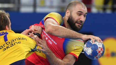 Sweden's Max Darj (L) jolds off Spain's Joan Canellas during the final match of the Men's 2018 EHF European Handball Championship between Spain and Sweden on January 28, 2018 in Zagreb.  / AFP PHOTO / Andrej ISAKOVIC