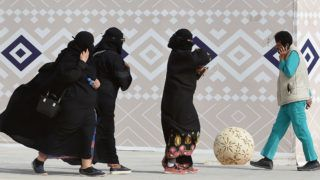 "A picture taken on January 19, 2018 shows Saudi women walking during the King Abdulaziz Camel Festival in Rumah, some 160 kilometres east of Riyadh. For decades the religious police, ""mutawa"" as they are known, wielded unbridled powers as arbiters of morality, patrolling streets and malls to snare women wearing bright nail polish and chastise men seeking contact with the opposite sex. In recent years, Saudi Arabia launched a series of reforms, including gradually diminishing the mutawa's powers to arrest. Crown Prince Mohammed bin Salman has further cut back the political role of hardline clerics in a historic reordering of the Saudi state.  / AFP PHOTO / FAYEZ NURELDINE"