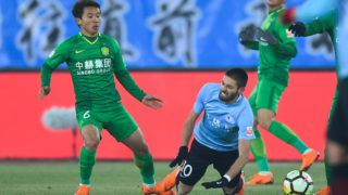 Belgian professional football player Yannick Ferreira Carrasco of Dalian Yifang, right, challenges Chi Zhongguo of Beijing Sinobo Guoan in their third round match during the 2018 Chinese Football Association Super League (CSL) in Dalian city, northeast China's Liaoning province, 16 March 2018.   Dalian Yifang was defeated by Beijing Guoan 0-3.