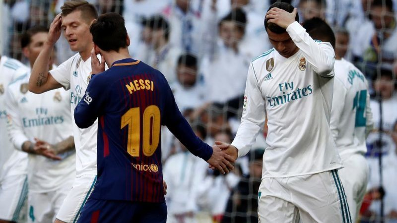 MADRID, SPAIN - DECEMBER 23: Cristiano Ronaldo (R) of Real Madrid and Lionel Messi (10) of Barcelona shake hands at the end of first half during the La Liga match between Real Madrid and Barcelona at Santiago Bernabeu Stadium in Madrid, Spain on December 23, 2017. Burak Akbulut / Anadolu Agency