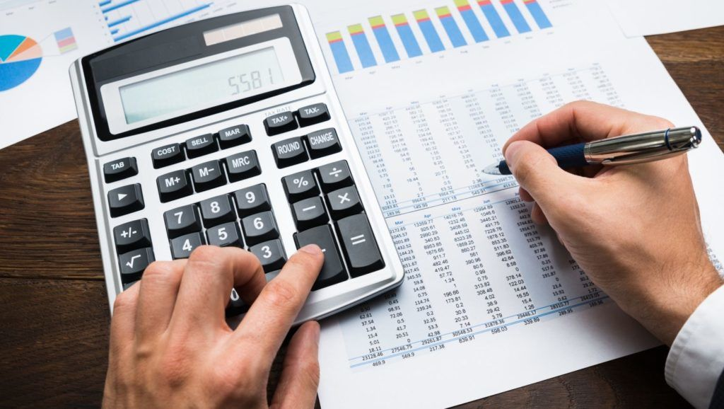 Businessman Analyzing Graph And Doing Financial Calculations