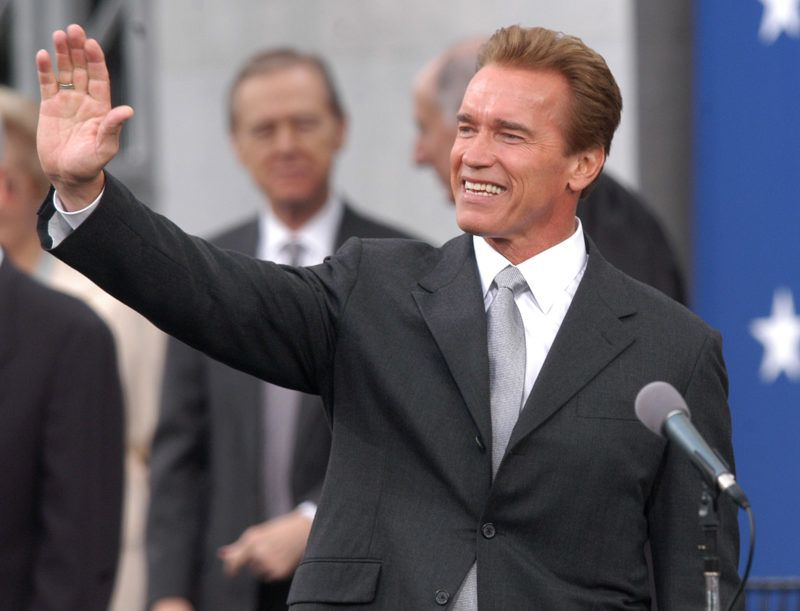 Arnold Schwarzenegger waves to the crowd after givigng his inaugural address as after being sworn in as California's 38th Governor during a ceremony at the State Capitol in Sacramento. (Photo by Steve Grayson/WireImage)