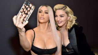 LOS ANGELES, CA - MARCH 06:  Kim Kardashian west and Madonna backstage at MDNA SKIN hosts Madonna and Kim Kardashian West for a beauty conversation at YouTube Space LA on March 6, 2018 in Los Angeles, California.  (Photo by Kevin Mazur/Getty Images for Madonna's MDNA SKIN)