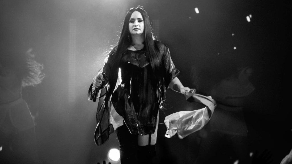 DETROIT, MI - MARCH 13:  (EDITORS NOTE: Image has been converted to black and white.) Demi Lovato performs in support of her Tell Me You Love Me Tour at Little Caesars Arena on March 13, 2018 in Detroit, Michigan.  (Photo by Scott Legato/Getty Images)