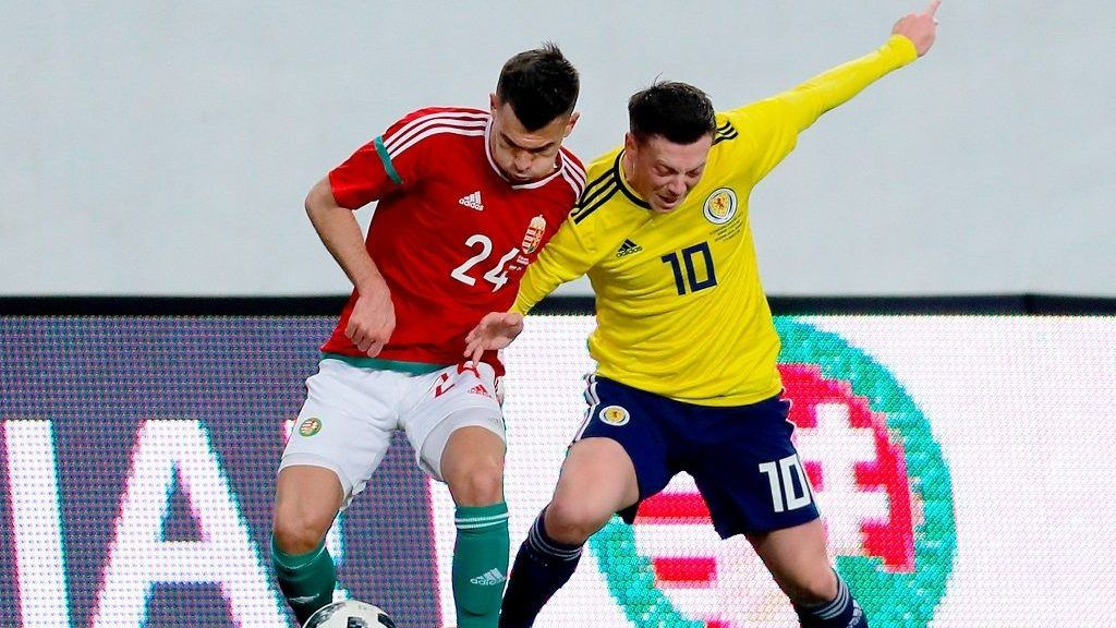 BUDAPEST, HUNGARY - MARCH 27:  Szilveszter Hangya of Hungary (l) and Callum McGregor of Scotland (r) in action during the International Friendly match between Hungary and Scotland at Groupama Arena on March 27, 2018 in Budapest, Hungary.  (Photo by Laszlo Szirtesi/Getty Images)