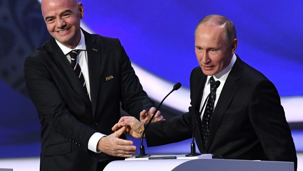 FIFA president Gianni Infantino (L) smiles with Russian President Vladimir Putin while delivering speeches during the 2018 FIFA World Cup football tournament final draw at the State Kremlin Palace in Moscow on December 1, 2017. The 2018 FIFA World Cup will be held between June 14 and July 15, 2018 in 11 Russian cities. / AFP PHOTO / Kirill KUDRYAVTSEV