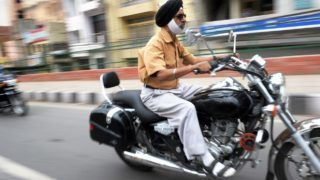 TO GO WITH STORY 'India-lifestyle-transport-helmet,FEATURE' by Abhaya Srivastava    A Sikh man drives a motorcycle in the streets of New Delhi on April 11, 2012.  While the law mandates a helmet for her male driver, a woman can legally travel without a helmet. India's federal Motor Vehicles Act of 1988 stated that every person driving or riding a two-wheeler had to wear a helmet, but this sparked an uproar from the Sikh community which raised religious objections. Sikh men were later exempted, largely because of the religious demand for them to wear turbans. The local New Delhi government decided it was impossible to tell a Sikh woman from a non-Sikh and so made helmets optional for all female motorcycle riders.     AFP PHOTO/ROBERTO SCHMIDT / AFP PHOTO / ROBERTO SCHMIDT