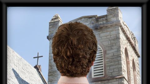 Back of man's head as he's watching flat screen television