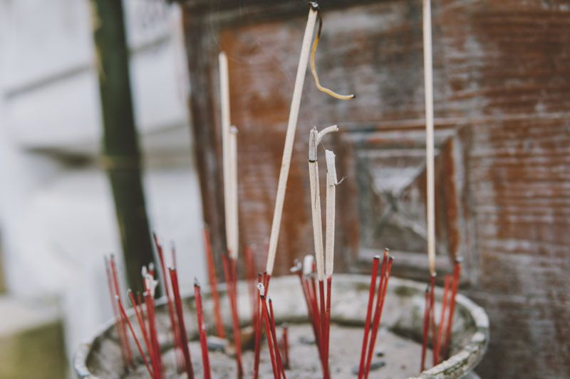 Smoldering incense in a Buddhist temple close-up. Excursions on Buddhist temples and pagodas of Thailand