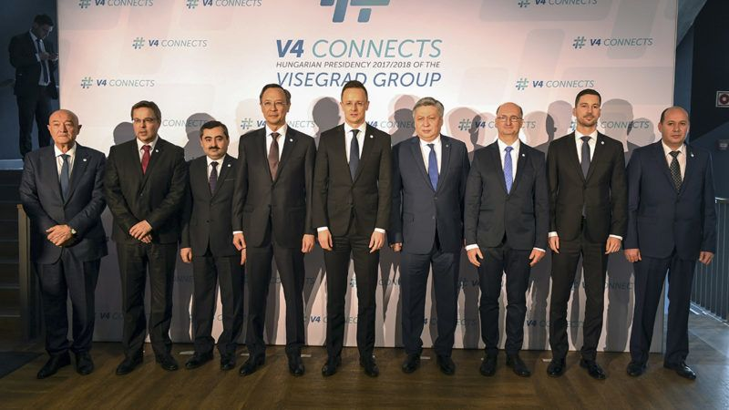 Participants of the meeting of the Visegrad 4 (Czech Republic, Hungary, Poland and Slovakia) foreign ministers and five counterparts from Central Asian countries (Kazakhstan, Kyrgyzstan, Tajikistan, Turkmenistan and Uzbekistan) pose for a family photo prior to their official talks, on February 27, 2018 in Budapest. From (L-R) Uzbekistan's deputy Foreign Minister Abdujabar Abduvahitov, Czech deputy FM Martin Tlapa, Tajikistan's deputy FM Muzaffar Huseinzoda, Kazakhstan's Foreign Minister Kairat Abdrakhmanov, Hungary's Foreign Minister Peter Szijjarto, KKyrgyz Foreign Minister Erlan Abdyldaev, Poland's deputy FM Piotr Wawrzyk, Slovakia's state secretary for Foreign Affairs Lukas Parizek and Turkmenistan's state secretary for Foreign Affairs Silapberdi Nurberdiev. / AFP PHOTO / ATTILA KISBENEDEK