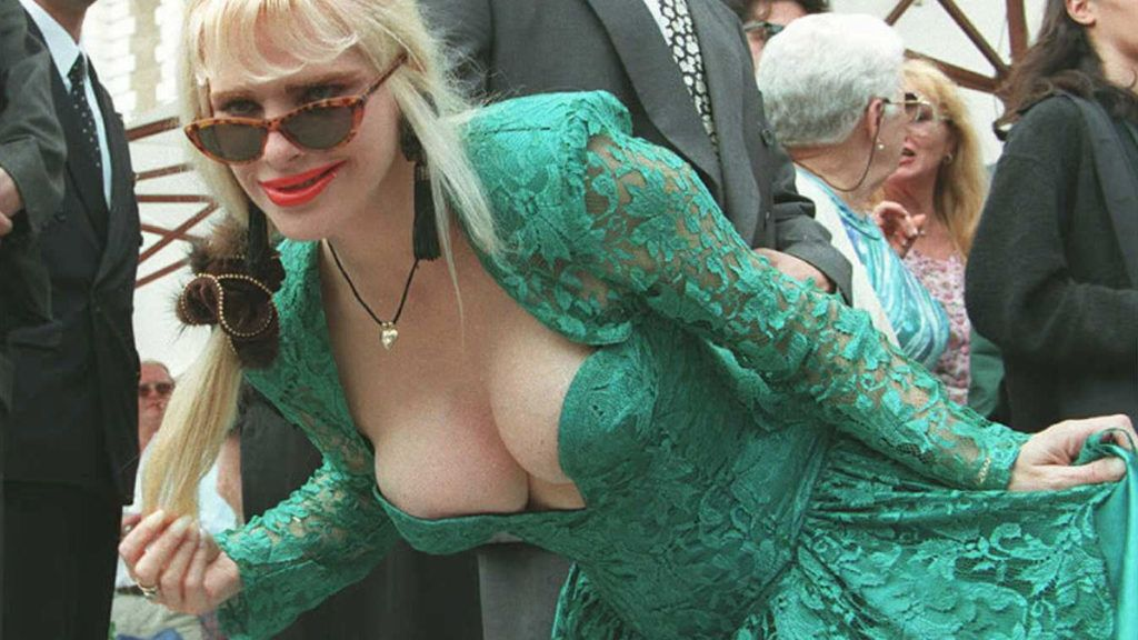 La Cicciolina, former Italian porno-star and former member of Italian Parliament, poses for photographers 15 May on the steps of one of the hotels on the Croisette at Cannes. La Cicciolina attended the X-award ceremony for the best porno-movies, on the fringes of the 49th International Film Festival.  AFP PHOTO  Andre DURAND / AFP PHOTO / ANDRE DURAND
