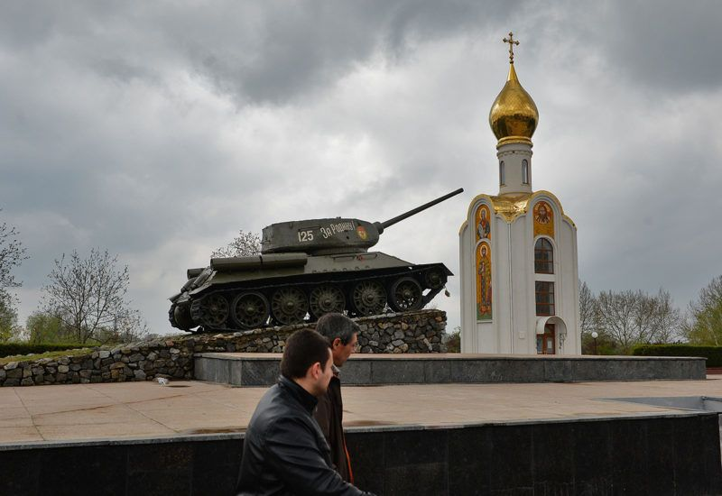 "People pass next to a soviet era tank, now a monument celebrating the victory of the Red Army against fascist Germany, in Tiraspol, the main city of Transdniestr separatist republic of Moldova April 16, 2014. Ukrainian Minister of foreign Affairs, Andrii Dechtchytsia, said was ""very concerned"" by Transnistria breakaway pro-Russian entity in Moldova, while Moscow has to proceed to the annexation of Crimea to Russia.  ""The situation in Transnistria is a major concern, not only for Ukraine, not only for Moldova"" stated Mr. Dechtchytsia during a press conference in the Brussels Forum of the German Marshall Fund. Transnistria, a small strip of land of 500,000 inhabitants in eastern Moldova, has won the support of Russia, a short war of independence after the collapse of the USSR in 1991. It is not recognized by the international community. AFP PHOTO DANIEL MIHAILESCU / AFP PHOTO / DANIEL MIHAILESCU"