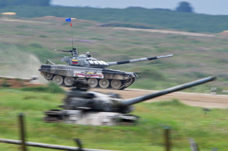 3162988 07/30/2017 Armenian Army team members take part in the tank biathlon individual race during the 2017 International Army Games at the Alabino training center in the Moscow Region. Iliya Pitalev/Sputnik