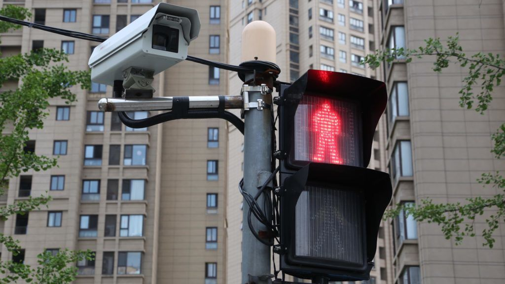 View of a trial electronic police device to catch jaywalkers on camera at an intersection in Shanghai, China, 6 July 2017.  Shanghai traffic police started using a trial electronic police device to catch jaywalkers on camera, xinmin.cn reported Monday (3 July 2017). Once the electronic system detects jaywalking, its camera will automatically record the incident, then identify the jaywalker through facial recognition software. After the perpetrator is identified, traffic police will notify the person to report to their office for an investigation. The first such trial device was installed at the intersection of Gonghexin Road and Yongxing Road at the end of May and has thus far caught over 300 cases of jaywalking. In a recent case, a jaywalker was given a penalty of 20 yuan ($2.95) by traffic police in Jing'an district.