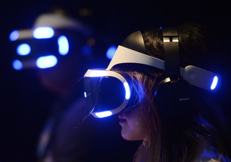 LOS ANGELES, CA - JUNE 14: Gamers try out the new Sony VR headset in Sony Playstation booth during the annual E3 2016 gaming conference at the Los Angeles Convention Center on June 14, 2016 in Los Angeles, California. The Electronic Entertainment Expo will run from June 14 -16.   Kevork Djansezian/Getty Images/AFP
