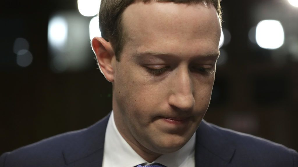 WASHINGTON, DC - APRIL 10: Facebook co-founder, Chairman and CEO Mark Zuckerberg arrives to testify before a combined Senate Judiciary and Commerce committee hearing in the Hart Senate Office Building on Capitol Hill April 10, 2018 in Washington, DC. Zuckerberg, 33, was called to testify after it was reported that 87 million Facebook users had their personal information harvested by Cambridge Analytica, a British political consulting firm linked to the Trump campaign.   Chip Somodevilla/Getty Images/AFP