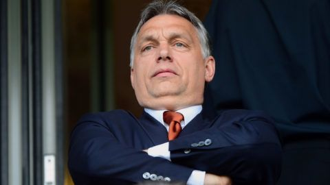 (FILES) This file photo taken on April 21, 2014 shows Hungarian Prime Minister Viktor Orban waiting for the beginning of the inauguration ceremony of the 'Pancho (alias Hungarian-Spanish football legend Ferenc Puskas) Stadium of Puskas Academy' in Felcsut village, Hungary. Football stadiums and street lamps may seem unlikely obstacles for Hungary's strongman Viktor Orban, who looks set to win a third consecutive term as prime minister in elections on April 8. However, allegations of fraud in the funding of such public projects has dogged his campaign.  / AFP PHOTO / ATTILA KISBENEDEK
