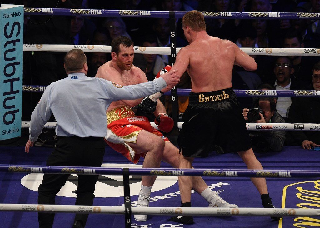 Alexander Povetkin (R) of Russia stops David Price of Britain (L) in the 5th round at Principality Stadium in Cardiff, March 31, 2018.  / AFP PHOTO / Oli SCARFF