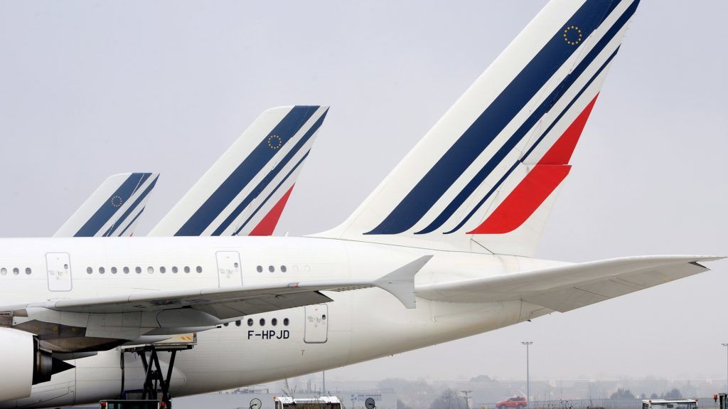 (FILES) A file photo taken on December 2, 2016 shows Airbus A380 jetliners bearing the Air France livery on the tarmac at Paris Roissy Charles-de-Gaulle airport. Air France's employees will go on strike on April 3, 2018 for the fourth time in a month to demand a six-percent general wage increase. / AFP PHOTO / ERIC PIERMONT