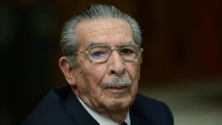 (FILES) In this file photo taken on March 19, 2013 former Guatemalan de facto President (1982-1983), retired General Jose Efrain Rios Montt, looks on during the opening of the trial on charges of genocide during his de facto 1982-83 regime, in Guatemala City. Efrain Rios Montt, a former military dictator who ruled Guatemala between 1982 and 1983 and who was facing retrial on genocide charges, died on April 1, 2018 aged 91, sources close to his family said. One of his lawyers, Jaime Hernandez, told reporters that Rios Montt died of heart failure in his home. / AFP PHOTO / Johan ORDONEZ