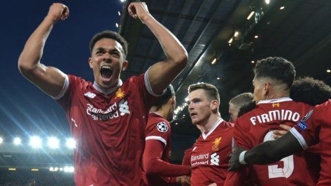 Liverpool's English midfielder Alex Oxlade-Chamberlain celebrates with teammates, scoring the team's second goal during the UEFA Champions League first leg quarter-final football match between Liverpool and Manchester City, at Anfield stadium in Liverpool, north west England on April 4, 2018. / AFP PHOTO / Anthony Devlin