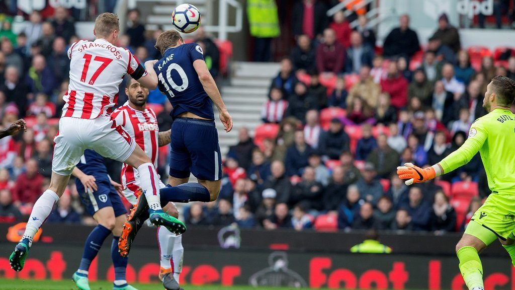 """Stoke City's English goalkeeper Jack Butland (R) watches the ball, struck by Tottenham Hotspur's Danish midfielder Christian Eriksen (unseen), roll into his net to score Tottenham's second goal during the English Premier League football match between Stoke City and Tottenham Hotspur at the Bet365 Stadium in Stoke-on-Trent, central England on April 7, 2018. / AFP PHOTO / Roland Harrison / RESTRICTED TO EDITORIAL USE. No use with unauthorized audio, video, data, fixture lists, club/league logos or 'live' services. Online in-match use limited to 75 images, no video emulation. No use in betting, games or single club/league/player publications.  / CORRECTING NAME OF GOAL SCORER """"The erroneous mention[s] appearing in the metadata of this photo by Roland Harrison has been modified in AFP systems in the following manner: [Stoke City's English goalkeeper Jack Butland (C) watches the ball, struck by Tottenham Hotspur's Danish midfielder Christian Eriksen (unseen), roll into his net to score Tottenham's second goal] instead of [Tottenham Hotspur's English striker Harry Kane (C) heads the ball past Stoke City's English goalkeeper Jack Butland to score his team's second goal ]. Please immediately remove the erroneous mention[s] from all your online services and delete it (them) from your servers. If you have been authorized by AFP to distribute it (them) to third parties, please ensure that the same actions are carried out by them. Failure to promptly comply with these instructions will entail liability on your part for any continued or post notification usage. Therefore we thank you very much for all your attention and prompt action. We are sorry for the inconvenience this notification may cause and remain at your disposal for any further information you may require."""""""