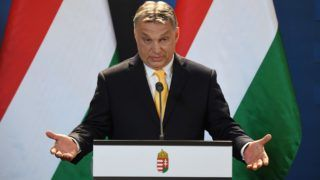 Hungarian Prime Minister Viktor Orban attends his first international press conference two days after his FIDESZ party won the parliamentary election, in the parliament building of Budapest on April 10, 2018. / AFP PHOTO / ATTILA KISBENEDEK
