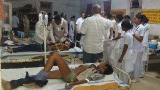 Indian accident survivors receive medical care at Sidhi's Civil hospital on April 18, 2018, after a truck carrying wedding revellers plunged late on April 17, when crossing Jogdha bridge over Son river, some 50kms from Sidhi town in Singrauli district of Madhya Pradesh state.   Police said on April 18 at least 21 revellers en route to a wedding were killed when their truck flew off a bridge, just the latest horrific crash on India's accident-prone roads. The truck carrying more than 40 passengers in central Madhya Pradesh state smashed through a protective railing late Tuesday and plunged nearly 20 metres to a dry riverbed below.  / AFP PHOTO / -