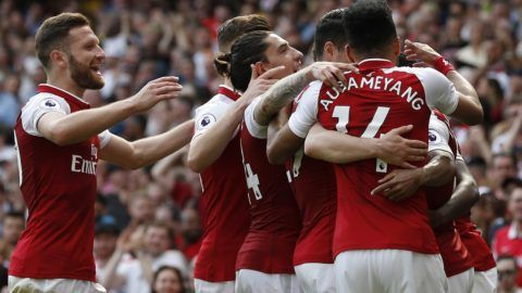 Arsenal's French striker Alexandre Lacazette is surrounded by teammates after scoring their fourth goal during the English Premier League football match between Arsenal and West Ham United at the Emirates Stadium in London on April 22, 2018.  / AFP PHOTO / Ian KINGTON / RESTRICTED TO EDITORIAL USE. No use with unauthorized audio, video, data, fixture lists, club/league logos or 'live' services. Online in-match use limited to 75 images, no video emulation. No use in betting, games or single club/league/player publications.  /