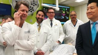 """This undated handout photo obtained April 23, 2018 courtesy of Johns Hopkins Medicine shows the medical team (L-R) Drs. Richard Redett,Trinity Bivalacqua, Brandacher Gerald, Arthur Bud Burnett and W.P. Andrew Lee(R), professor and director of plastic and reconstructive surgery at the Johns Hopkins University School of Medicine standing near a mannequin. Doctors at Johns Hopkins University said April 23, 2018 they have performed the world's first total penis and scrotum transplant on a US military serviceman who was wounded in Afghanistan.The 14-hour operation took place on March 26, and was performed by a team of nine plastic surgeons and two urology surgeons, JHU said in a statement.""""We are hopeful that this transplant will help restore near-normal urinary and sexual functions for this young man,"""" said W.P. Andrew Lee, professor and director of plastic and reconstructive surgery at the Johns Hopkins University School of Medicine. The entire penis, scrotum without testicles and partial abdominal wall came from a deceased donor.   / AFP PHOTO / Johns Hopkins Medicine / Handout / RESTRICTED TO EDITORIAL USE - MANDATORY CREDIT """"AFP PHOTO / JOHNS HOPKINS MEDICINE/HANDOUT"""" - NO MARKETING NO ADVERTISING CAMPAIGNS - DISTRIBUTED AS A SERVICE TO CLIENTS"""