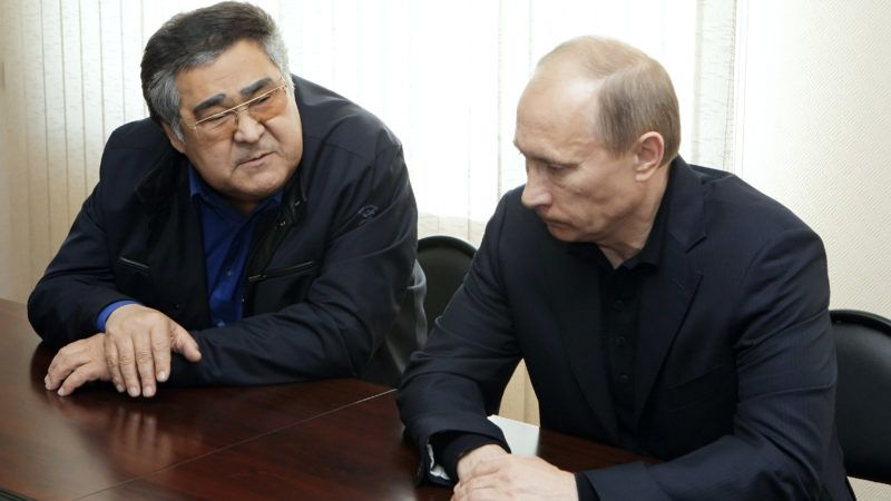 Russia's Prime Minister Vladimir Putin (R) and Governor of the Kemerovo region Aman Tuleyev (L) meet with relatives of victims of an underground explosion at the Raspadskaya mine in Novokuznetsk on May 11, 2010. The death toll from the Siberian coal mine disaster at the weekend rose to 43 on Tuesday and dozens of workers were still missing in a maze of tunnels threatened by flooding, emergency officials said.  AFP PHOTO / RIA NOVOSTI / POOL ALEXEI NIKOLSKY / AFP PHOTO / RIA NOVOSTI / ALEXEI NIKOLSKY