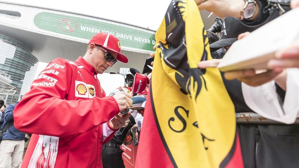 Finnish F1 driver Kimi Raikkonen of Ferrari signs autographs for fans at the Shanghai International Circuit before the 2018 Formula 1 Chinese Grand Prix in Shanghai, China, 12 April 2018.