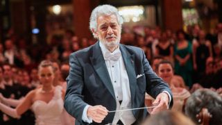 """Vienna Philharmonic Ball at Wiener Musikverein in Vienna, Austria, on January 18, 2018. PICTURE:   Opera singer and conductor Placido DOMINGO and musicians perform at the opening ceremony of the Ball of the Vienna Philharmonic Orchestra (Photo credit should read """"Starpix/APA-PictureDesk via AFP"""")"""