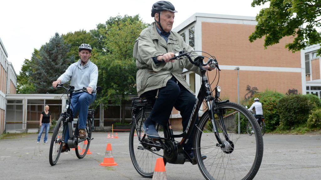 Senior citizens riding Pedelec electric bikes through a course in Muelheim,Germany, 12 September 2015. The e-bike safety courses for seniors are organised by the Muelheim police sports club. Photo: Caroline Seidel/dpa