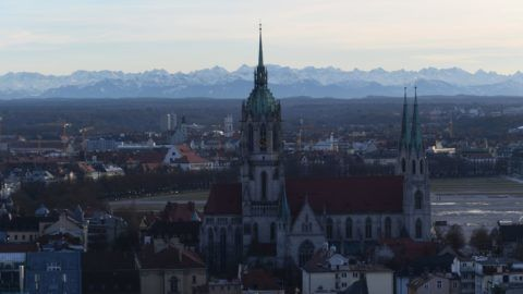 The state capital of Bavaria can be seen around sunset, with St. Paul's Church and the alps framing the backdrop of Munich, Germany, 24 January 2018. Photo: Felix Hörhager/dpa