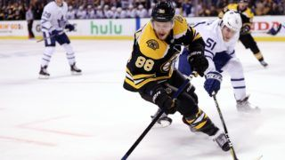 BOSTON, MA - APRIL 14: Jake Gardiner #51 of the Toronto Maple Leafs defends David Pastrnak #88 of the Boston Bruins during the first period of Game Two of the Eastern Conference First Round during the 2018 NHL Stanley Cup Playoffs at TD Garden on April 14, 2018 in Boston, Massachusetts.   Maddie Meyer/Getty Images/AFP