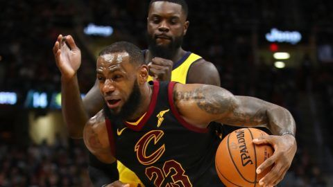 CLEVELAND, OH - APRIL 15: LeBron James #23 of the Cleveland Cavaliers drives past Lance Stephenson #1 of the Indiana Pacers during the second half in Game One of the Eastern Conference Quarterfinals during the 2018 NBA Playoffs at Quicken Loans Arena on April 15, 2018 in Cleveland, Ohio. Indiana won the game 98-80 to take a 1-0 series lead. NOTE TO USER: User expressly acknowledges and agrees that, by downloading and or using this photograph, User is consenting to the terms and conditions of the Getty Images License Agreement.   Gregory Shamus/Getty Images/AFP