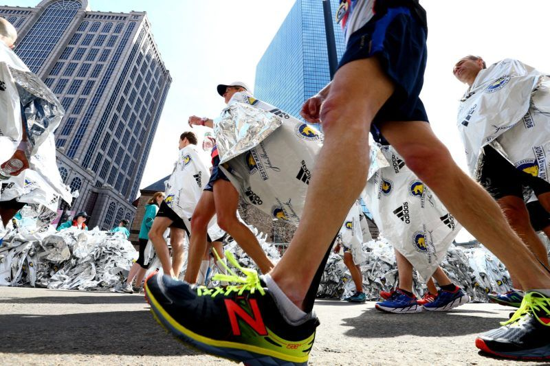 BOSTON, MA - APRIL 18: Runners walk through Copley Square after finishing the the 120th Boston Marathon on April 18, 2016 in Boston, Massachusetts.   Maddie Meyer/Getty Images/AFP