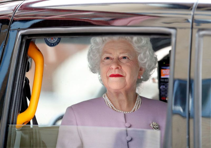 LONDON, UNITED KINGDOM - APRIL 23: (EMBARGOED FOR PUBLICATION IN UK NEWSPAPERS UNTIL 24 HOURS AFTER CREATE DATE AND TIME) A waxwork of Queen Elizabeth II is driven in a London Taxi past the Lindo Wing of St Mary's Hospital following the news that Catherine, Duchess of Cambridge has given birth to a baby boy on April 23, 2018 in London, England. The Duchess of Cambridge delivered a boy at 11:01 am, weighing 8lbs 7oz, who will be fifth in line to the throne. (Photo by Max Mumby/Indigo/Getty Images)