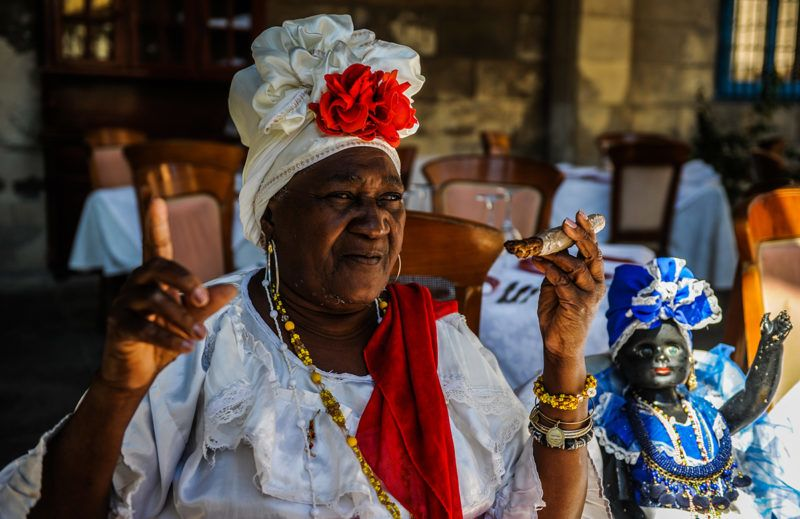 Cuban fortune teller Juana la Cubana, 75, gets ready to work in a street of Havana, on April 3, 2018. People from diverse places and different professions are waiting expectantly to see the first generational change in Cuba in almost 60 years. / AFP PHOTO / YAMIL LAGE / TO GO WITH AFP STORY by RIGOBERTO DIAZ