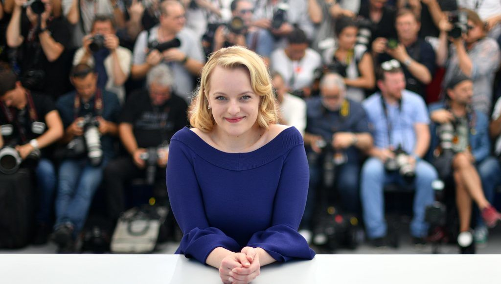 US actress Elisabeth Moss poses on May 23, 2017 during a photocall for the tv series 'Top Of The Lake: China Girl' at the 70th edition of the Cannes Film Festival in Cannes, southern France.  / AFP PHOTO / LOIC VENANCE