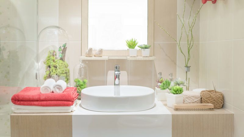 Washbasin with towel and decoration in bathroom