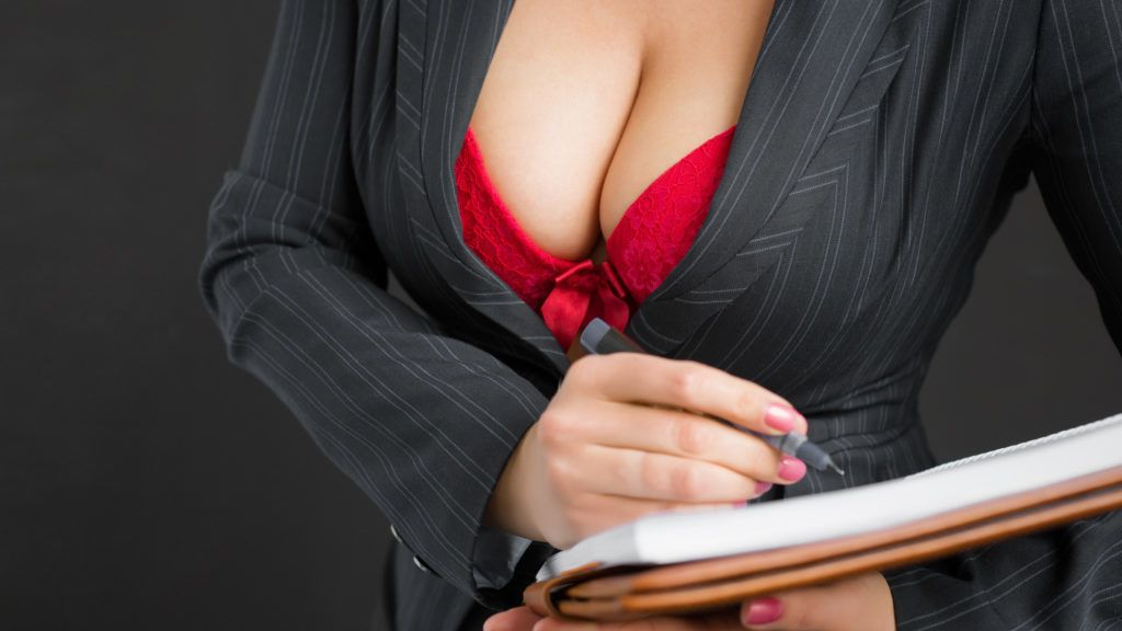 Sexy secretary with beautiful cleavage