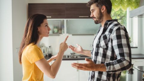 Couple having argument in kitchen at home