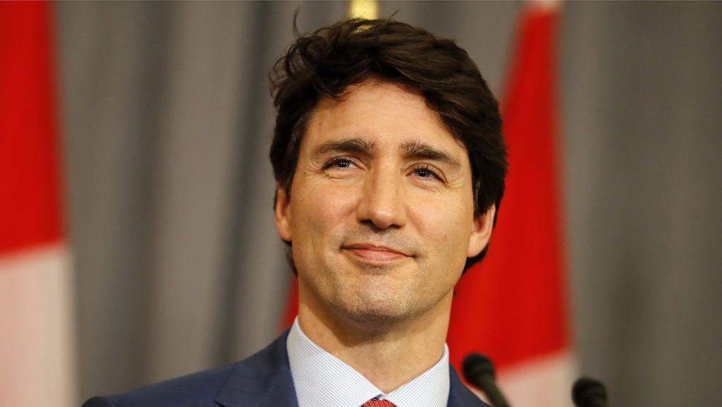 Canada's Prime Minister Justin Trudeau smiles during a press conference in central London, on the sidelines of the Commonwealth Heads of Government Meeting (CHOGM) on April 19, 2018.  / AFP PHOTO / Tolga AKMEN
